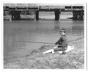 Primary view of object titled '[Photograph of a Boy Fishing at Bachman Lake]'.