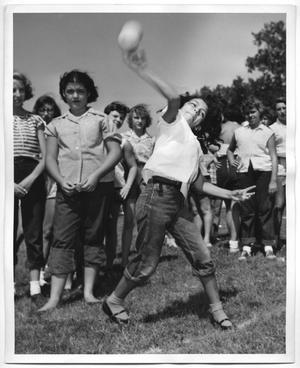 Primary view of object titled '[Photograph of Dominga Luna Throwing a Softball]'.