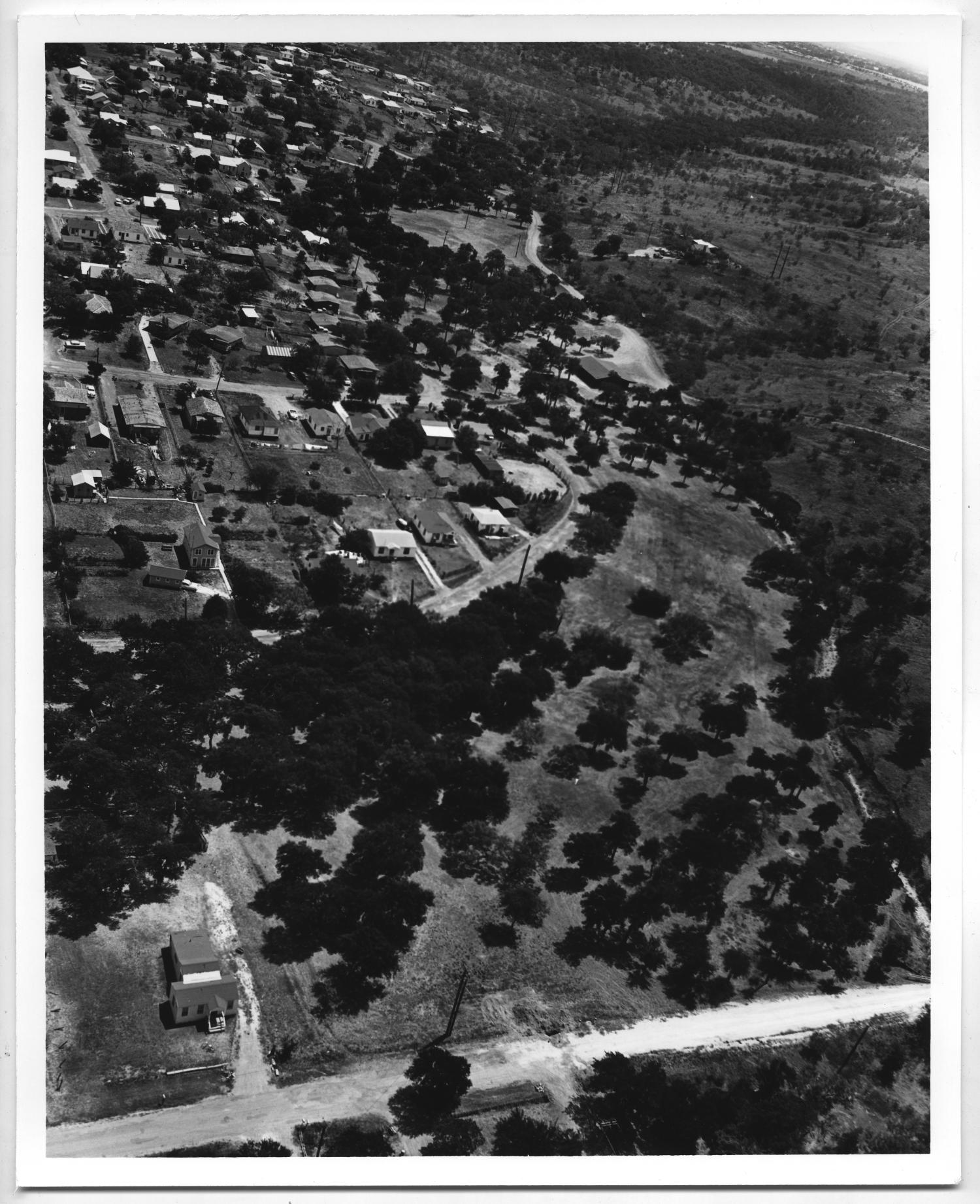 [Aerial View of Houses and Trees]                                                                                                      [Sequence #]: 1 of 2