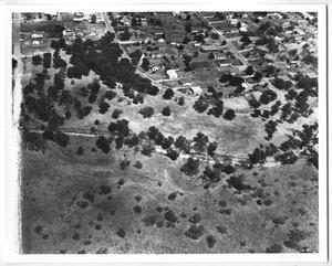 Primary view of object titled '[Aerial View of Houses and Trees]'.