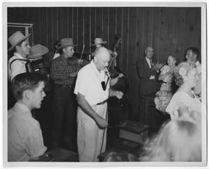 Primary view of object titled '[Photograph of a Band and People Dancing]'.