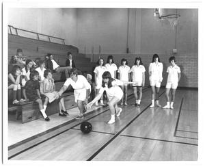 Primary view of object titled '[Photograph of Students Learning How to Bowl at a School Gym]'.