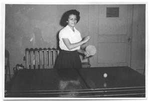 Primary view of object titled '[Photograph of a Woman Playing Ping Pong]'.