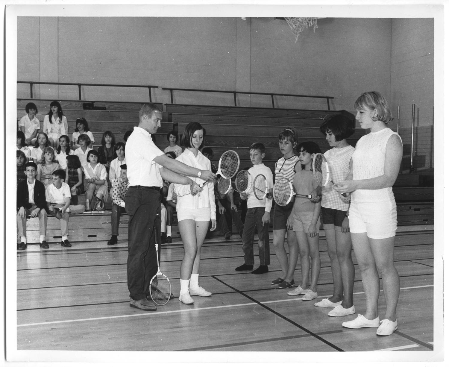 [Photograph of Students Learning How to Hold a Badminton Racket]                                                                                                      [Sequence #]: 1 of 2