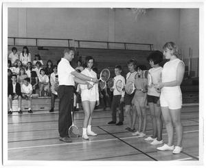 Primary view of object titled '[Photograph of Students Learning How to Hold a Badminton Racket]'.