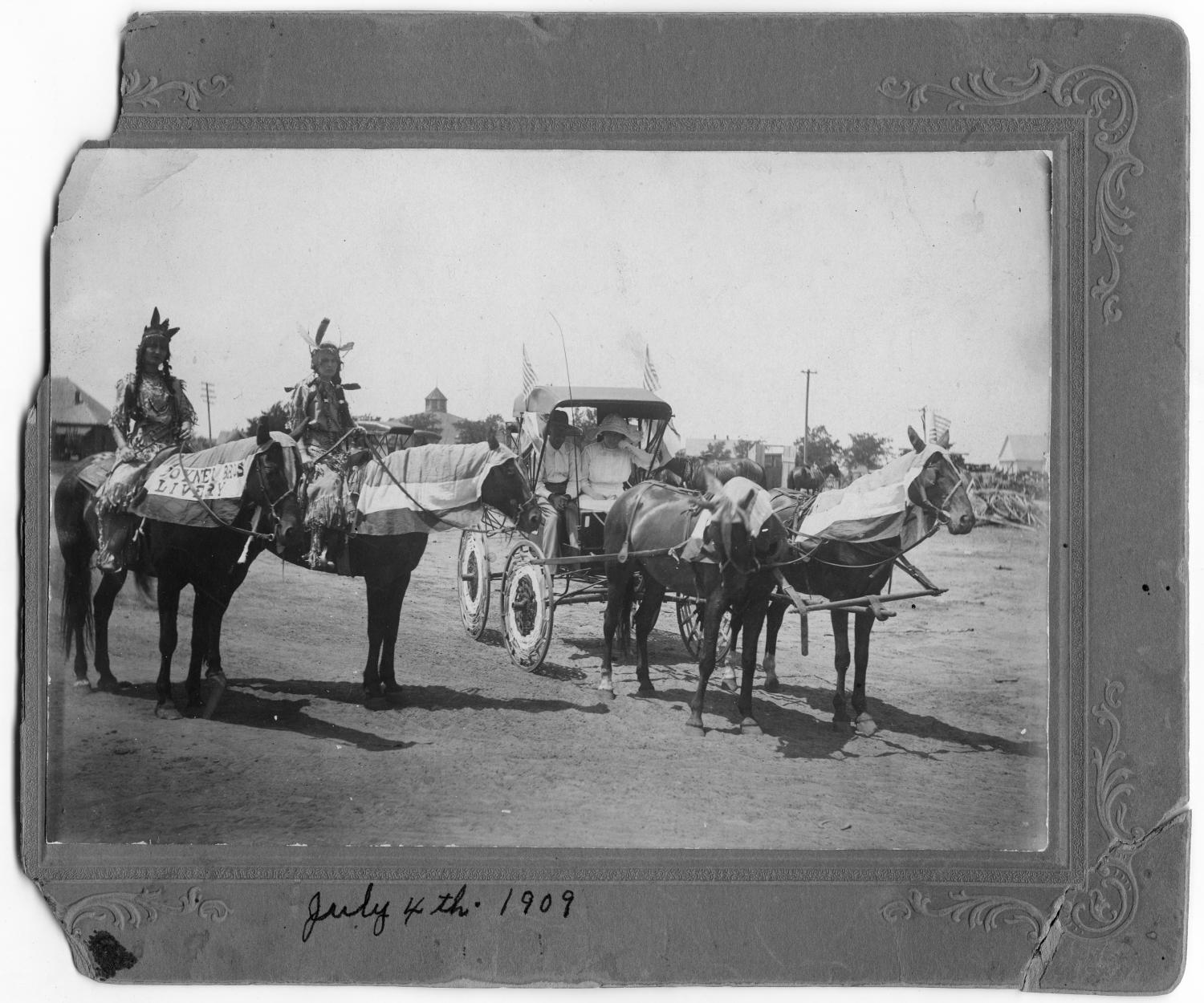 [Buggy and two horses in parade]                                                                                                      [Sequence #]: 1 of 2