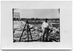Primary view of object titled '[Jim White standing on highway]'.