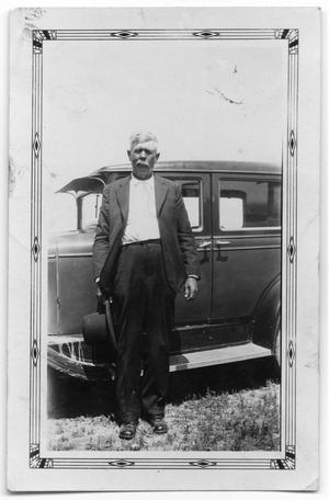 Primary view of [Dowl Chambliss standing by car]