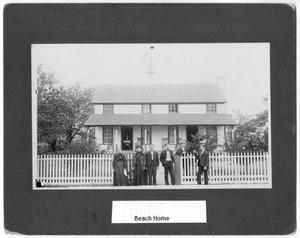 Primary view of object titled '[Beach family in front of home]'.