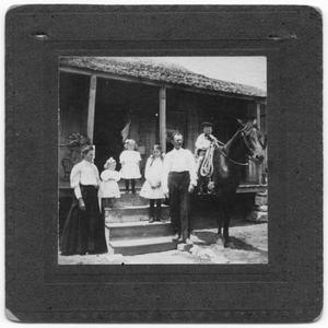 Primary view of object titled '[Family standing on porch]'.