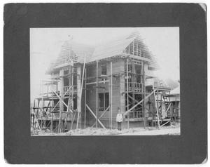 Primary view of object titled '[Men constructing house]'.
