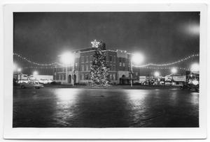 Primary view of object titled '[Collingsworth County Courthouse during Christmas]'.