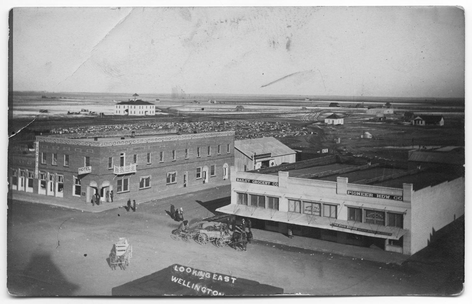 [Aerial view of Wellington State Bank and Wellington Hotel]                                                                                                      [Sequence #]: 1 of 2