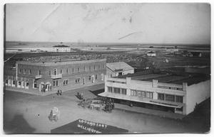 Primary view of object titled '[Aerial view of Wellington State Bank and Wellington Hotel]'.