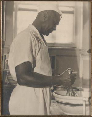 Primary view of object titled '[T. C. Hill in the kitchen at Texas State College for Women, 1944]'.