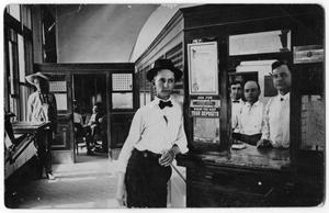 [Young man standing in bank]