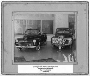 Primary view of object titled '[Cars at Collingsworth Motor Company]'.