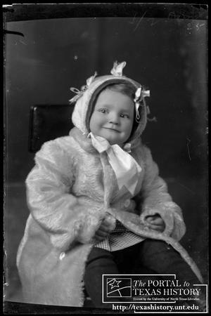 Primary view of object titled '[Young child wearing a fur coat]'.
