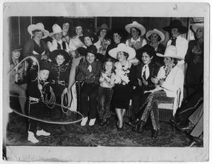 Primary view of object titled 'Cowgirls from the Madison Square Garden Rodeo with Mrs. William Randolph Hearst, 1932'.