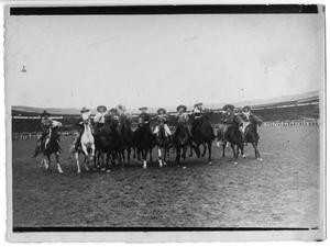 Primary view of object titled 'Ruth Roach [with other rodeo riders, on tour in Europe], 1924'.