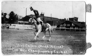 Primary view of object titled 'Bob Calen trick riding - Cowboy Championship Contest, c. 1920'.