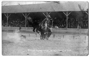 "Primary view of object titled 'Billie Kingham winning first money at Blackfoot, Idaho, on ""Lightning Creek"", c. 1920'."