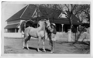 Primary view of object titled 'Ruth Roach Salmon [with a horse in Nocona, Texas], c. 1958'.