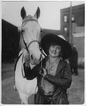 "Primary view of object titled 'Ruth Roach with [her horse] ""Silver Lady"", January 1931'."