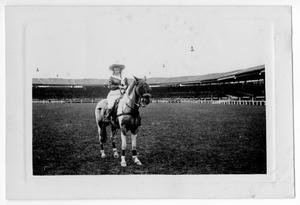 Primary view of object titled '[Ruth Roach astride a horse in an arena in Paris, France]'.