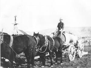 Primary view of object titled 'John Strickland Driving a Water Wagon'.