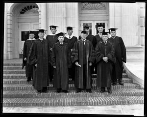 Primary view of object titled '[Ten unidentified men in caps and gowns pose on steps]'.