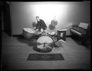 Primary view of object titled '[Unidentified man posing with timpani and drums]'.