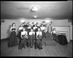 Primary view of object titled '[Serenaders playing for dance in dining room on first floor of Household Arts Building]'.