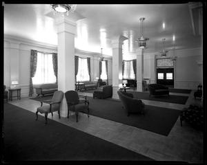 Interior view of a room with armchairs and columns