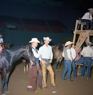 Primary view of object titled '[Men at the NCHA Tournament of Champions]'.