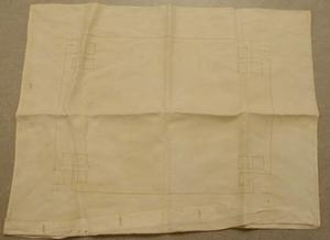Primary view of object titled 'white pillow case with buttons'.