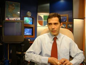 [Carlos Tamez away from the newsdesk]