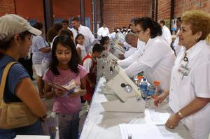 Primary view of object titled '[Optometrists provide vision screening services at a back to school fair]'.