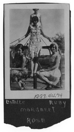 [Photograph of Four Young Women on a Carousel]