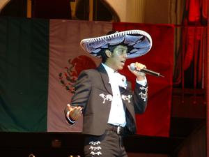 Primary view of object titled '[Man with sombrero and microphone]'.