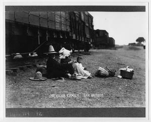 [Photograph of a family next to train tracks]