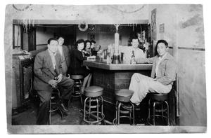 Primary view of object titled '[Group of men and women in a restaurant]'.