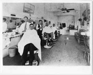Primary view of object titled '[Barbers and Men inside La Preferencia Barber Shop]'.