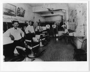 Primary view of object titled '[Barbers posing inside La Preferencia Barber Shop]'.