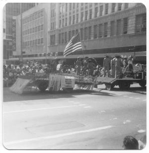 Primary view of object titled '[Houston Mexican Chamber of Commerce float in front of Kress building]'.