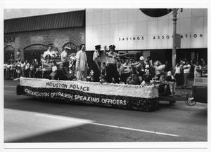 Primary view of object titled '[Houston Police Organization of Spanish Speaking Officers float]'.