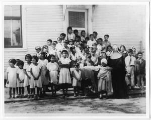 Primary view of object titled '[Children receiving clothes for school]'.