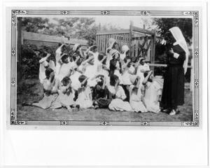 Primary view of object titled '[Catechist teaching children the sign of the cross]'.