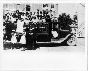 Primary view of object titled '[Children and nuns in a truck]'.