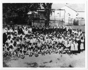 Primary view of object titled '[Group of children in Guadalupe Church yard]'.